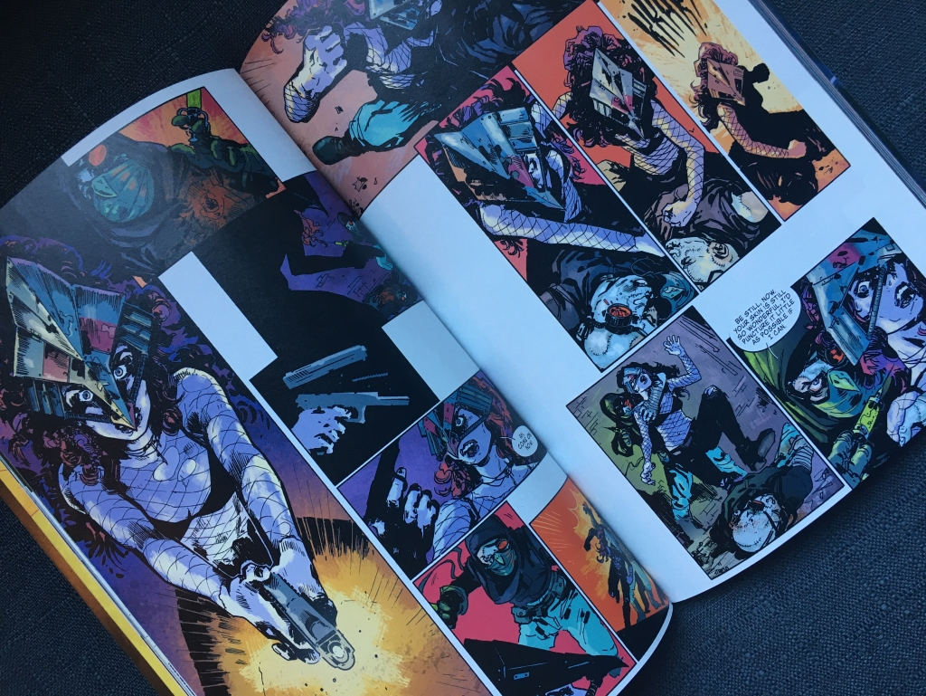 A two-page spread of volume one of COFFIN BOUND