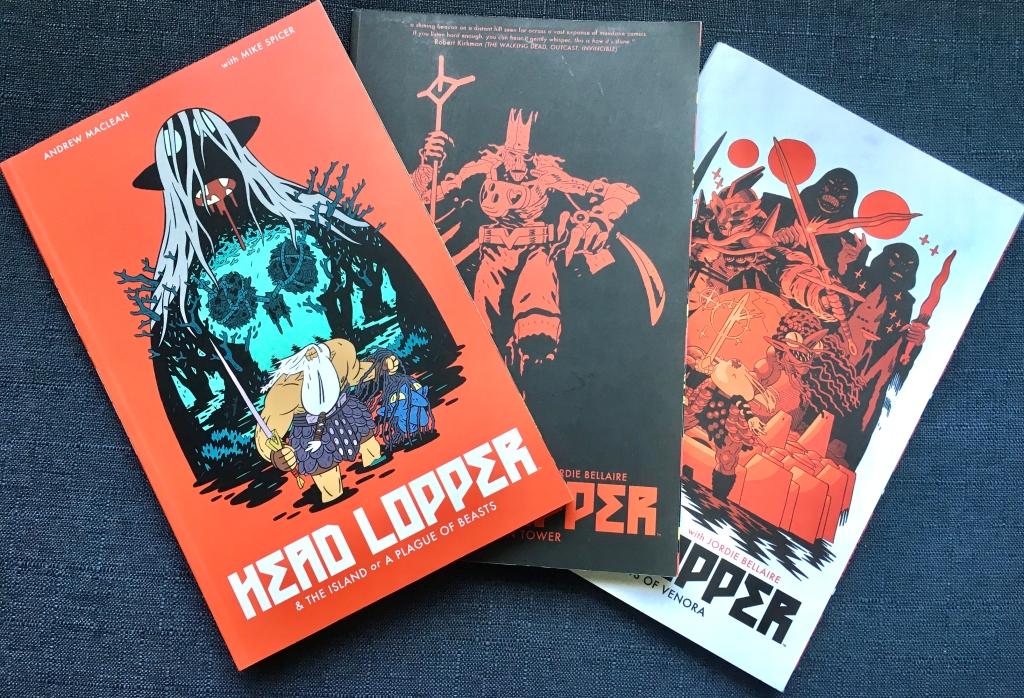 A photograph of all three current HEAD LOPPER volumes